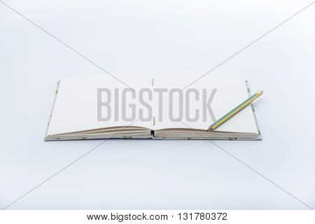 Closeup of open handmade book on white background