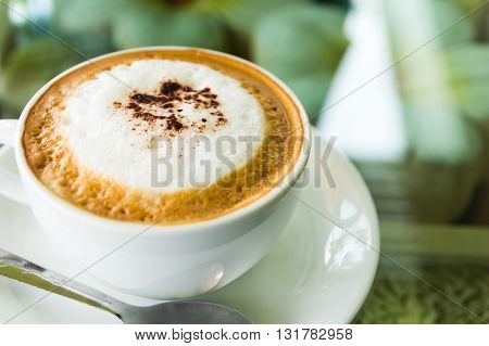close up of coffee on glass table