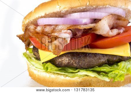 hamburger with bacon and chop isolated on white background closeup