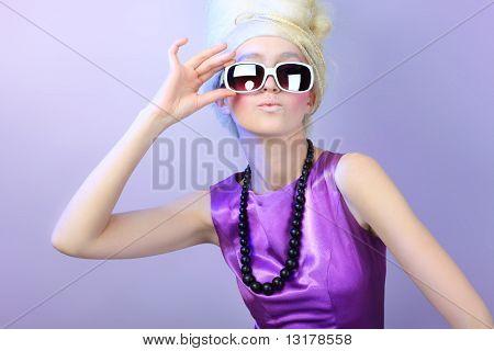 Portrait of a fashionable woman in sunglasses. Studio shot.