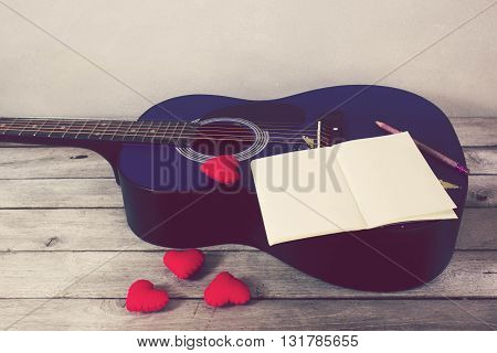 Vintage tone:guitar Heart Book Pencil on wood table