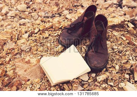 Vintage tone: Leather Shoe and book on Orange rocks