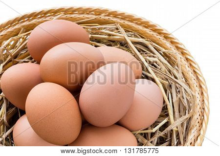 brown chicken eggs in basket isolated on white background