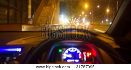 blur driving a car on road with Night traffic road bokeh light abstract background