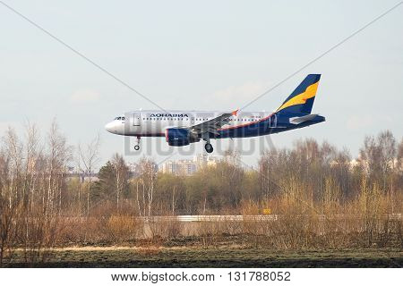 SAINT PETERSBURG, RUSSIA - APRIL 16, 2016: The Airbus A319-111 VP-BNB) airlines Donavia before landing in Pulkovo airport