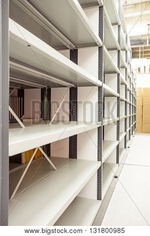 several movable shelves in the basement of the building