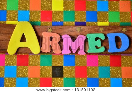 armed word on a abstract colorful background