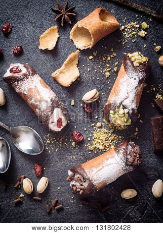 Photos of cannoli time on rustic background
