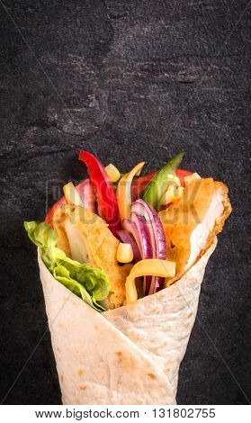 Photos of chicken wrap sandwich on rustic background