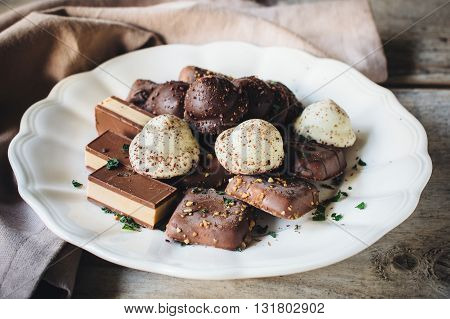 Photos of chocolate time on rustic background