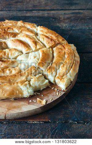 Photos of homemade cheese pie on rustic background