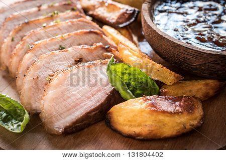 Photos of pork fillet on rustic background