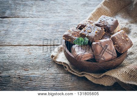 Sweet biscuite in the bowl on rustic background