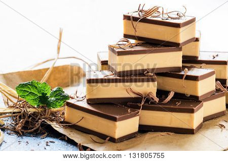 Photos of sweet pralines on rustic background