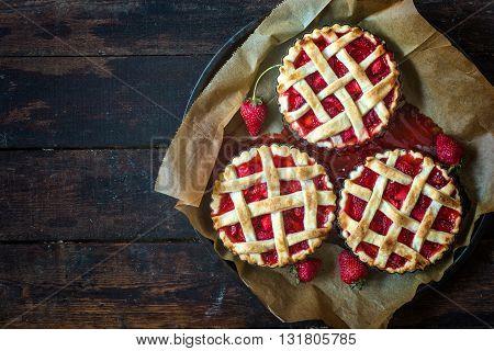 Sweet strawberries tart cake on rustic background