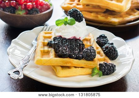 Photos of sweet waffles on rustic background
