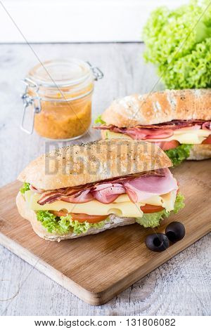 Photos of tasty sandwiches on rustic background