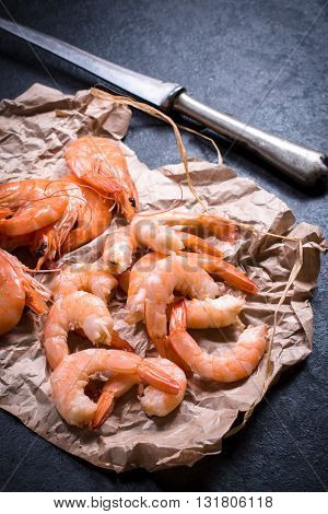 Photos of tiger shrimps on rustic background