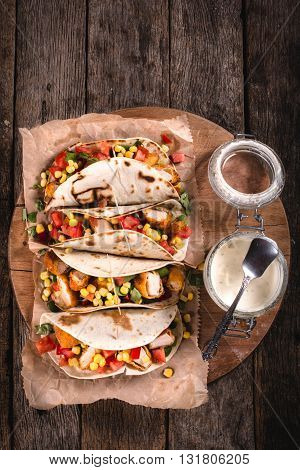 Photos of tortilla sandwiches on rustic background