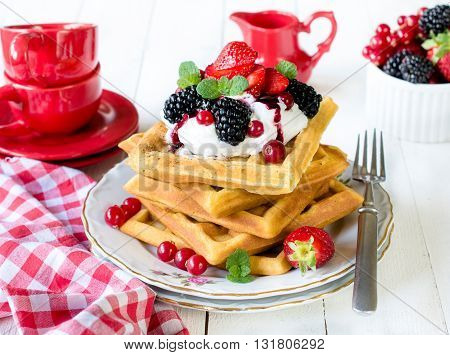 Photos of traditional waffles on rustic background