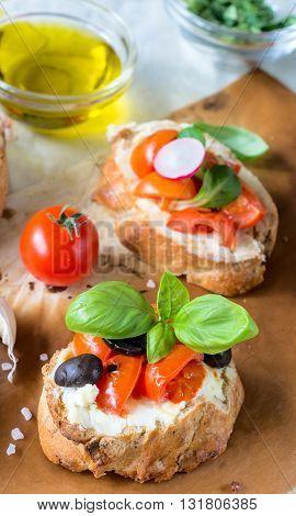 Photos of vegetarian bruschetta on rustic background