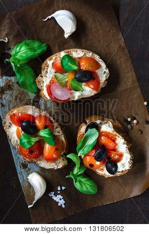 Photos of veggan bruschettas on rustic background