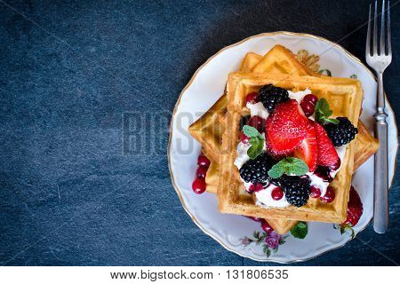 Photos of waffles time on rustic background