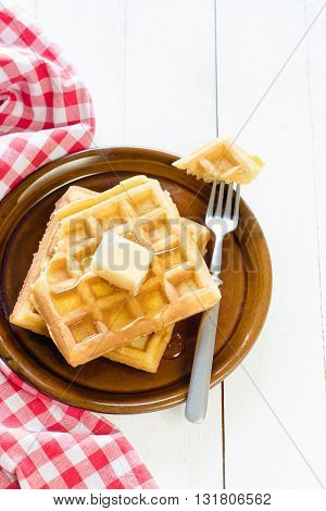 Photos of waffles with honey on rustic background