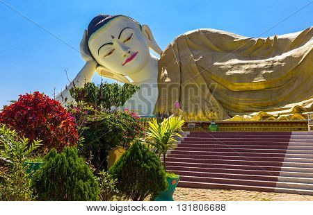 Bago, Myanmar - January 10, 2012: The huge statue of the reclining Buddha (Shwethalyaung Buddha)