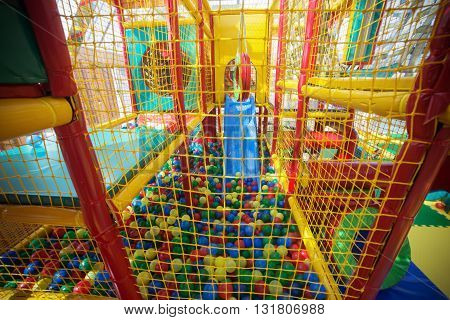 Indoor playground with colorful plastic balls for children.