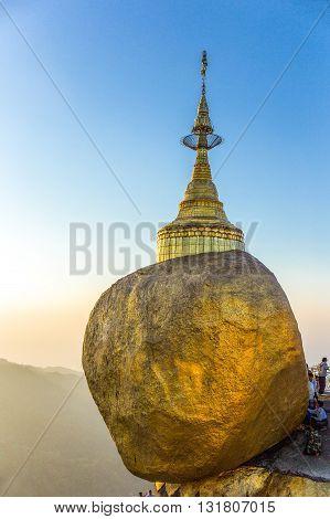 Kyaikhto,  Myanmar - January 10, 2012:  The delicately balanced golden Stupa on the sacred Buddhist mountain