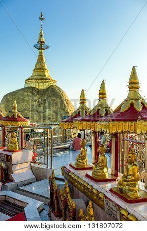 Kyaikhto Myanmar - January 10 2012: Buddha shrines near the delicately balanced golden Stupa on the sacred Buddhist mountain