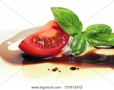 fresh tomato slice with oil and balsamic vinegar.