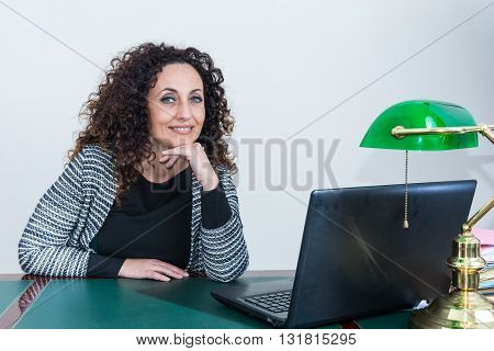 Portrait of mature woman in his studio. With curly hair blacks or dark green eyes on white or clear.