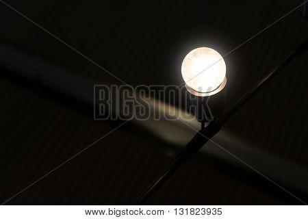 Spiral bulb turn light in dark place. luminous Fluorescent Spiral lamp bulb turn on bright in dark place. like found idea from thinking in unclear situation, solve the problem or way to be creative and success