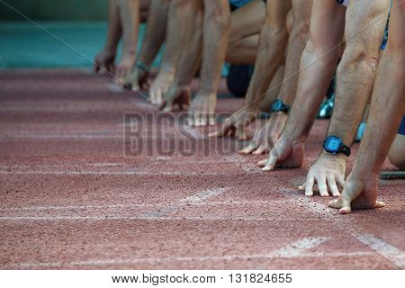 Hands on the starting line.Athletes at the sprint start line in track and field