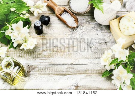 Spa setting with jasmine flowers and essential oil. Wellness concept top view
