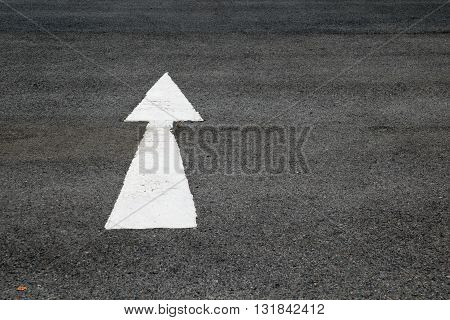 arrows painted on a cement floor. arrow, direction, road, stree