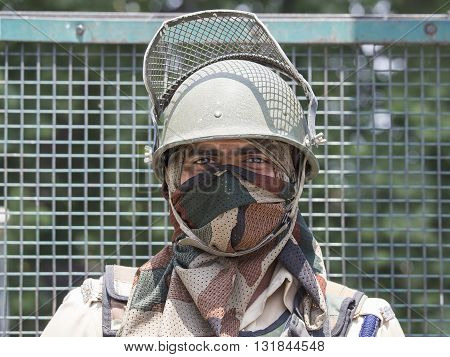 SRINAGAR INDIA - JUNE 11 2015: Unknown Indian frontier guard. Indian Army checkpoint in Kashmir Himalayas. Kashmir became dangerous again.