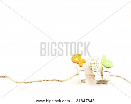 Wooden paper clips on brown string with four five six popular telephone number for thai people believed in lucky number concept