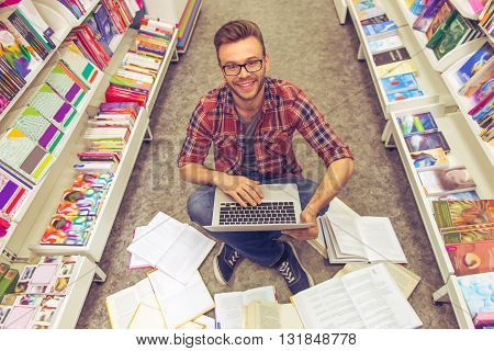 Guy With Gadget At The Bookshop