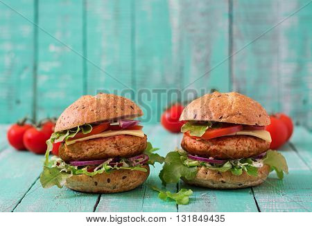 Big Sandwich - Hamburger With Juicy Chicken Burger, Cheese, Tomato, And Red Onion On Wooden Backgrou