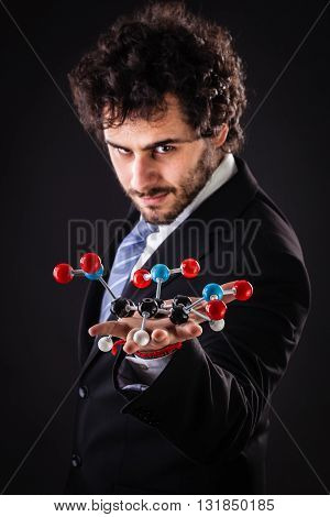 Businessman Holding Tnt Molecular Structure