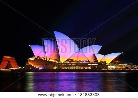 SYDNEY AUSTRALIA - MAY 29 2016; Sydney Opera House in moving colour of patterns shapes and lines during the Vivid Sydney Annual Event. Showing pretty sunrise colours on the sails of the Opera House.