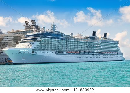 PHILIPSBURG, ST. MAARTEN - JAN. 19 2011: The Celebrity Solstice cruise ship anchored in the Caribbean island of St. Maarten is owned and operated by Royal Caribbean Cruises.