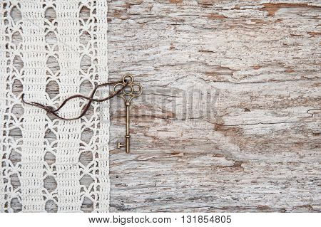Vintage Background With Old Key And Lace On The Rude Wood