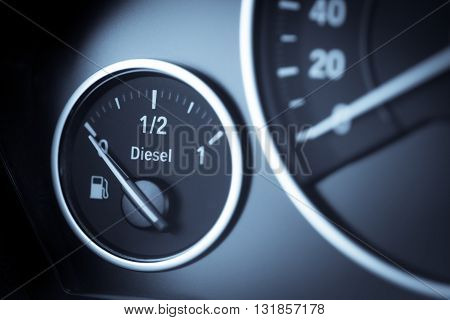 Close-up horizontal shot of a diesel fuel gauge in a car.