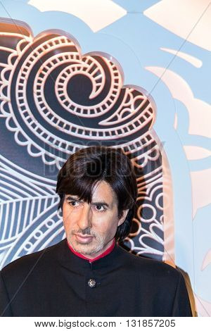 LONDON UK - JUNE 7 2015: Amitabh Bachchan Bollywood actor in Madame Tussaud wax museum. It is one of major tourist attraction.