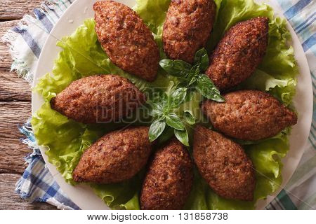 Arabic Kubbeh Tasty Meatballs Close Up On A Plate. Horizontal Top View