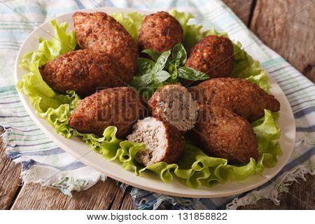Hot Kibbeh Meatballs With Bulgur And Pine Nuts Closeup. Horizontal